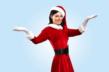 Santa Girl presenting your product, in costume and white gloves Stock Photo - 15695965
