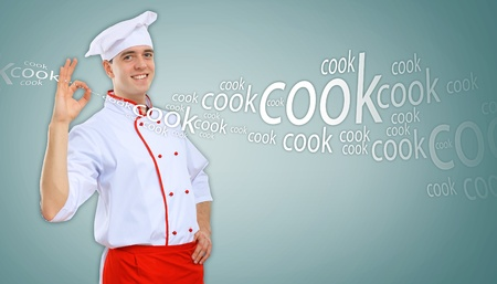 Portrait of a young male cook in red apron against colour background Stock Photo - 15696675