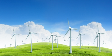 resource conservation: Alternative energy   Group of energy-producing windmills agains blue sky