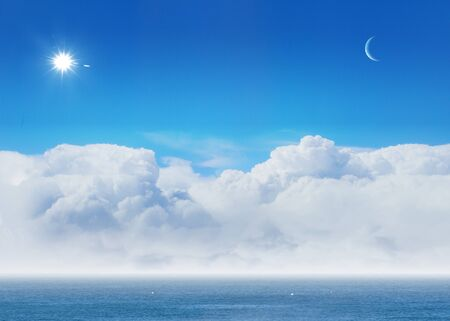 bright blue sky with sun shining and some clouds Stock Photo