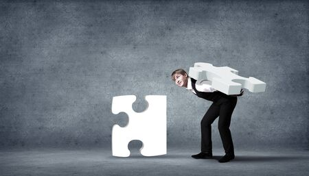Team of business people collaborate holding up jigsaw puzzle pieces as a solution to a problem Stock Photo - 15765619