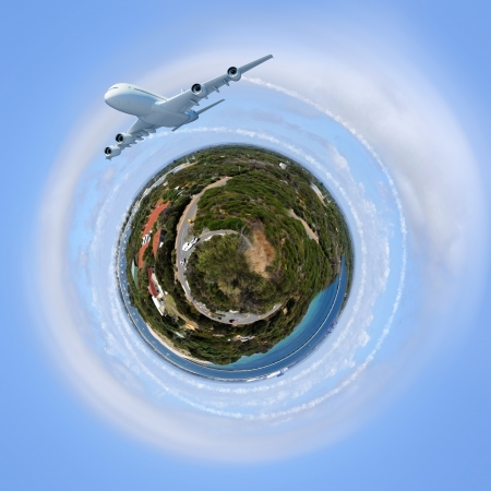 Planet earth against sky background and plane flying around it photo