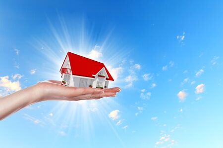 Hand holding   offer house  Real estate concept  Handful collection  photo
