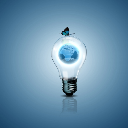 future city: Electric light bulb and our planet inside it as symbol of green energy