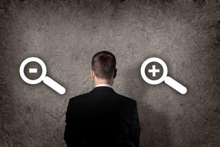 Business concept - a businessman choosing decrease or increase photo