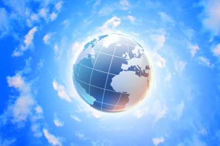 Planet earth against blue cloudy sky background photo
