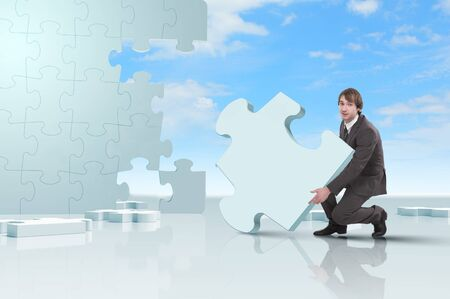 solves: Businessman with a puzzle pieces on the background