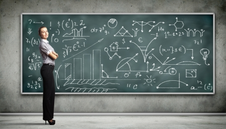 Business person standing against the blackboard with a lot of data written on it photo