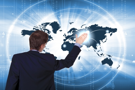 Modern Business World, A businessman navigating virtual world map Stock Photo - 15862414