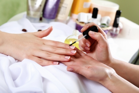 manicure salon: Female hands and manicure related objects in spa salon