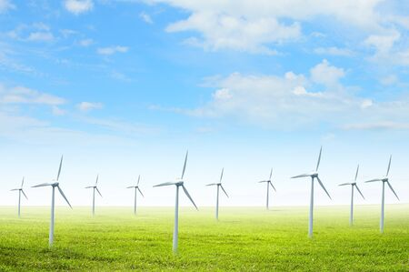 Alternative energy  Group of energy-producing windmills  Concept photo