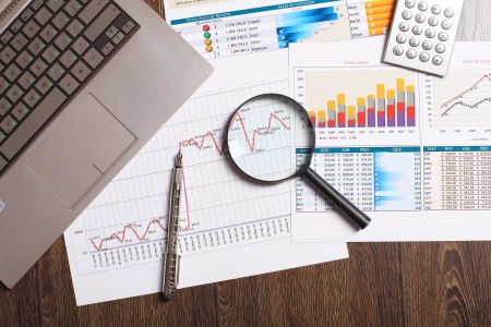 statistic: Image of a businessman workplace with papers Stock Photo