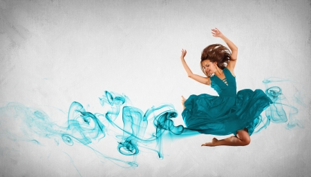 Portrait of a dancing young woman with blue smoke curles photo