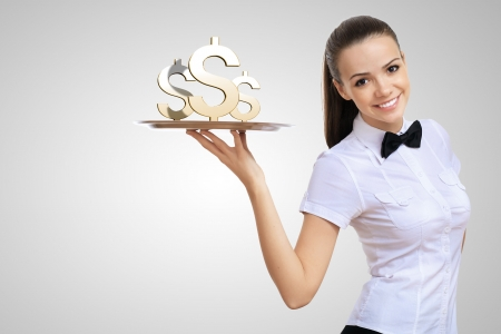 Waitress holding a tray with money on it Stock Photo - 15965232