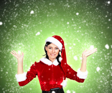 cloath: Portrait of beautiful girl wearing santa claus clothes on red background Stock Photo