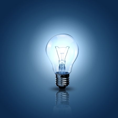 Light bulb lamps on a colour background photo