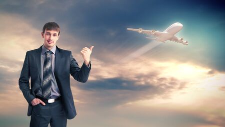 Businesman and plane on the background against cloudy sky Stock Photo - 15965331