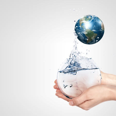 Globe in human hand against blue sky  Environmental protection concept  Elements of this image furnished by NASA photo
