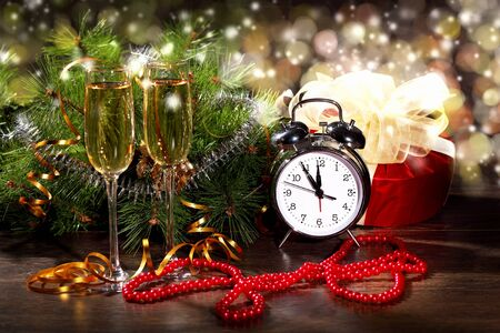 New Year s collage with glasses of champagne  Decorations and ribbons on a bright color background photo