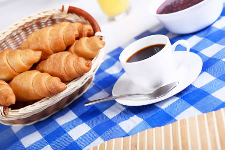 continental: Continental breakfast with croisant and black coffee Stock Photo