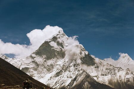 High mountains in white cloud  Nepal  Everest photo