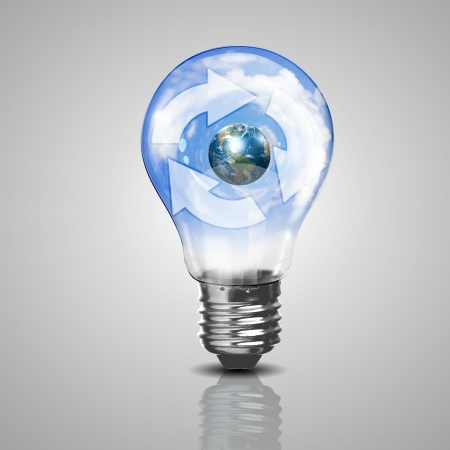 Electric light bulb and our planet inside it as symbol of green energy Stock Photo - 16137048