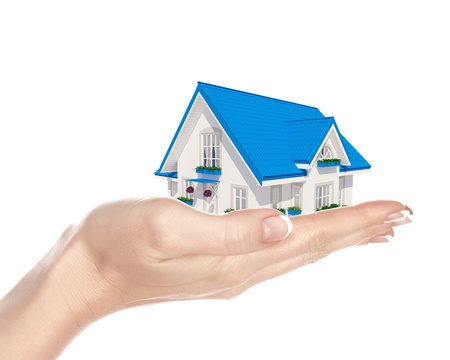 house insurance: The house with colour roof in human hands