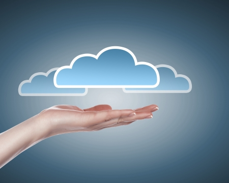 Hand with cloud computing symbol against colour background photo