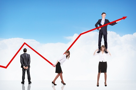 business people pushing a business graph upwards photo