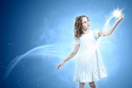 Little girl with magic lights and shining around Stock Photo - 16304889