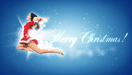 Happy smiling woman in red xmas costume jumping high Stock Photo - 16304886
