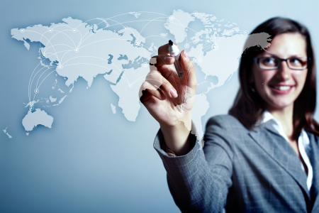 Modern Business World, A businessman navigating virtual world map Stock Photo - 16227452