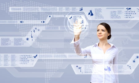 touchscreen: Young woman in business wear working with digital touch screen Stock Photo