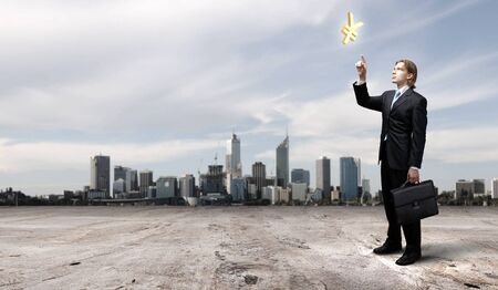 businessman in blue suit standing and juggling business symbols photo