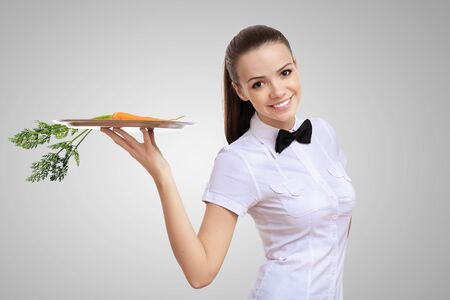 Waitress with a carrot on her tray photo