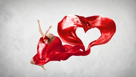 Young woman dancing with red fabric in studio and heart symbol Stock Photo - 16353238