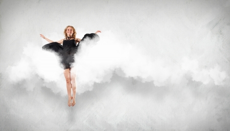 Portrait of a dancing young woman with white cloudy smoke Stock Photo - 16353225
