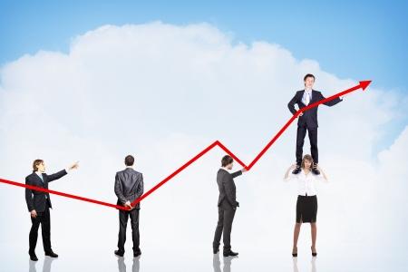 business people pushing a business graph upwards Stock Photo - 16352465
