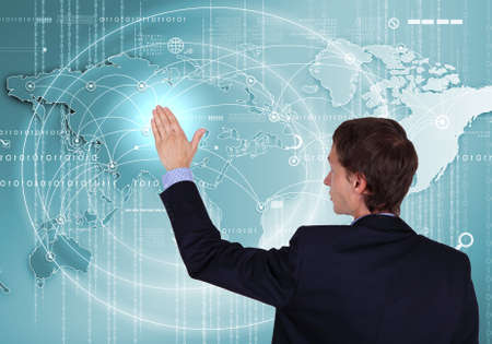 Modern Business World, A businessman navigating virtual world map Stock Photo - 16353243