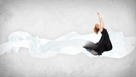 Portrait of a dancing young woman with white fabric Stock Photo - 16353223