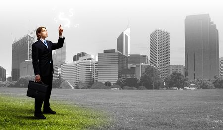 global economy: Image of a business man standing against cityscape