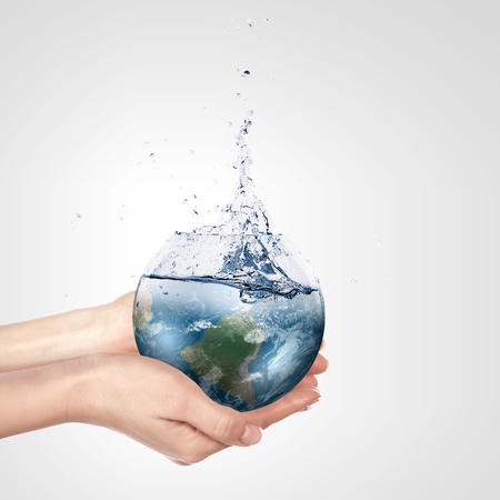 blue planet: Globe in human hand against blue sky  Environmental protection concept  Elements of this image furnished by NASA