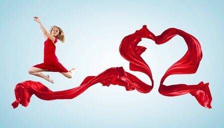 Young woman dancing with red fabric in studio and heart symbol Stock Photo - 16548876
