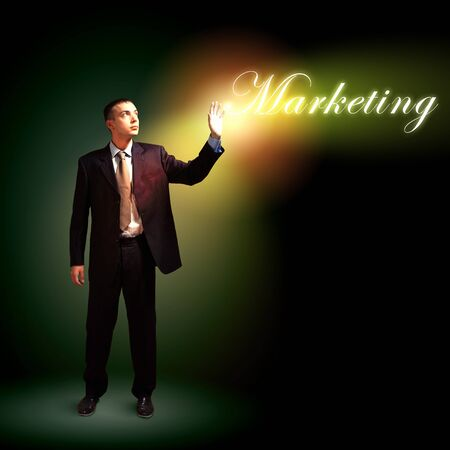 lfinancing: Young successful businessman holding a shining light in his hand as a symbol of success and advancement