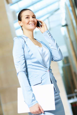 Portrait of happy smiling young businesswoman in office Stock Photo - 16548591
