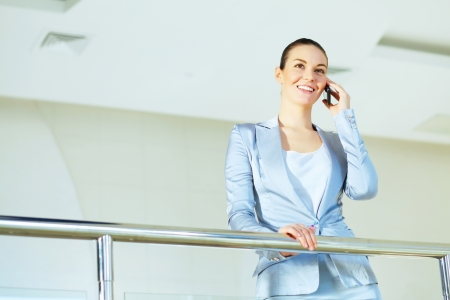 Portrait of happy smiling young businesswoman in office Stock Photo - 16548835
