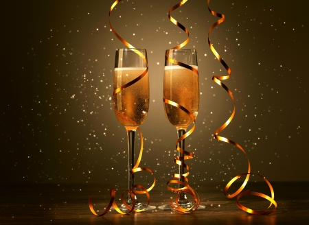 bring: Two champagne glasses ready to bring in the New Year