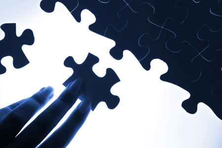puzzle piece coming down into its place Stock Photo - 16524702