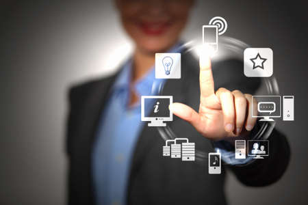 Business person pushing symbols on a touch screen interface Stock Photo - 16548837