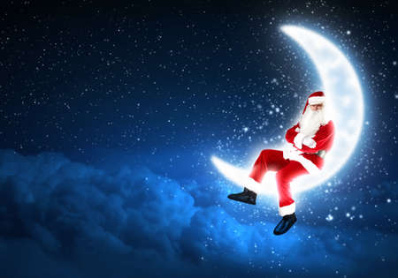 a Santa Claus sitting on shiny moon above winter forest Stock Photo - 16548830